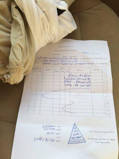 Met dit papier, dat bewijst dat ze onze camera's hebben afgepakt, moeten we naar Misrata.