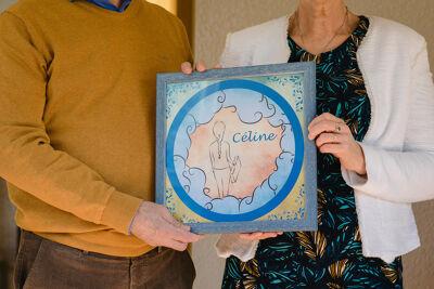 de ouders van Céline met de sticker