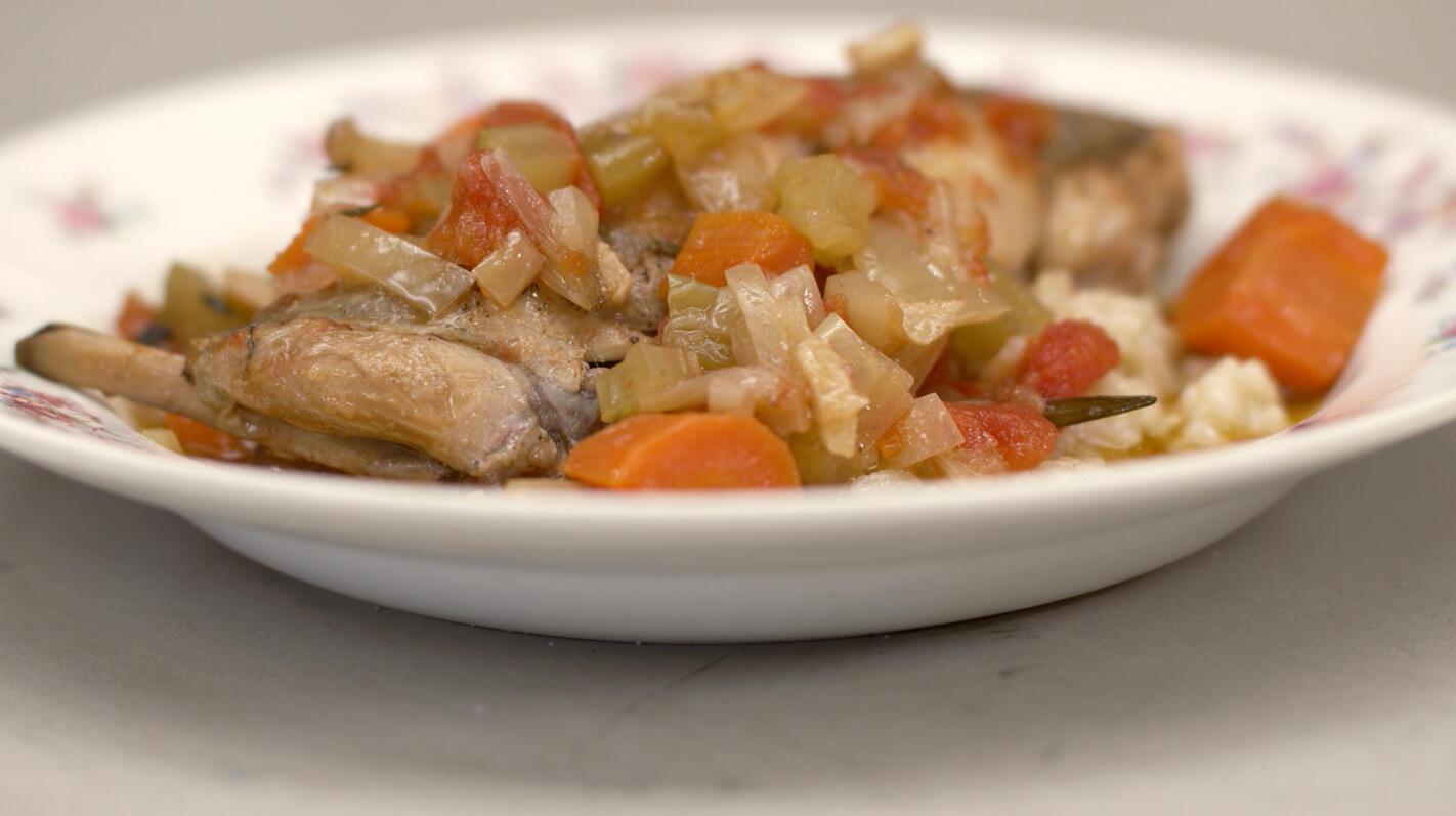 Konijnenbouten in de oven met risotto
