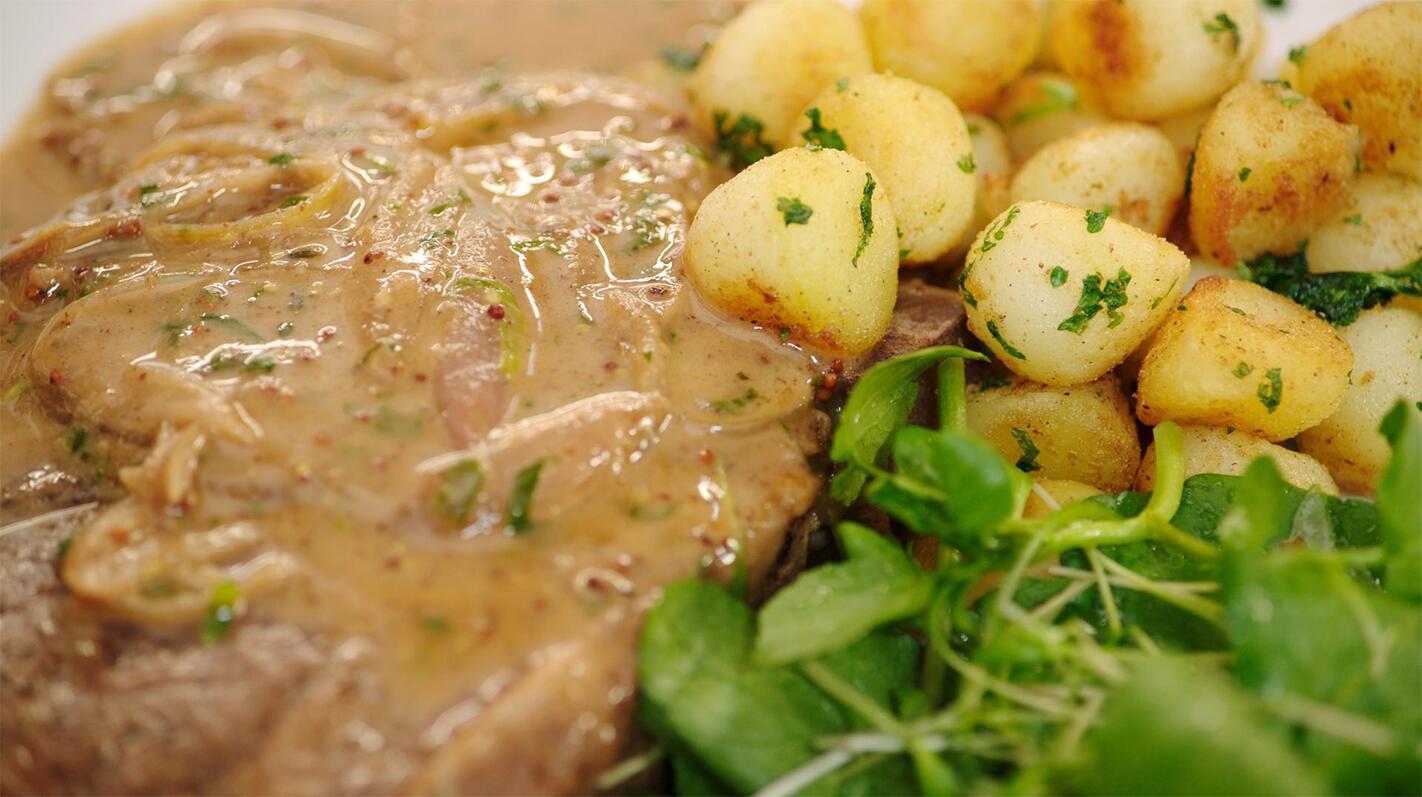 Varkensspiering met Parisienne aardappelen en waterkers