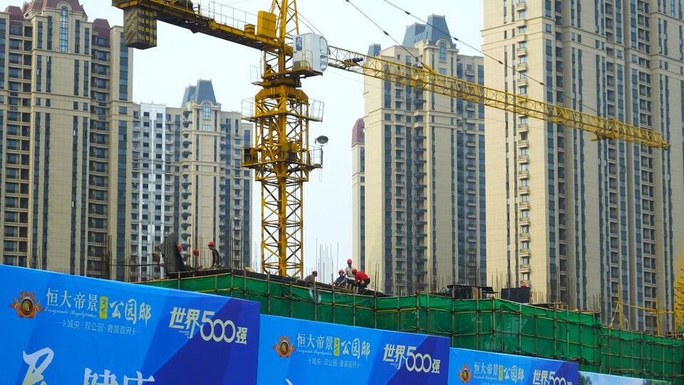 Failliete Chinese vastgoedgigant Evergrande kan wereld in crisis storten